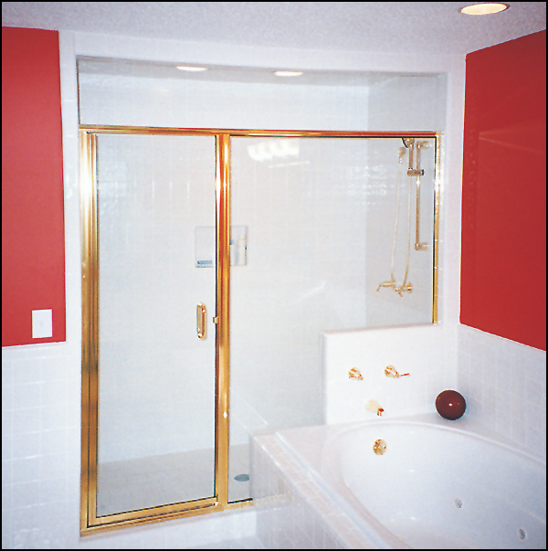 wall framed shower enclosure with swinging door