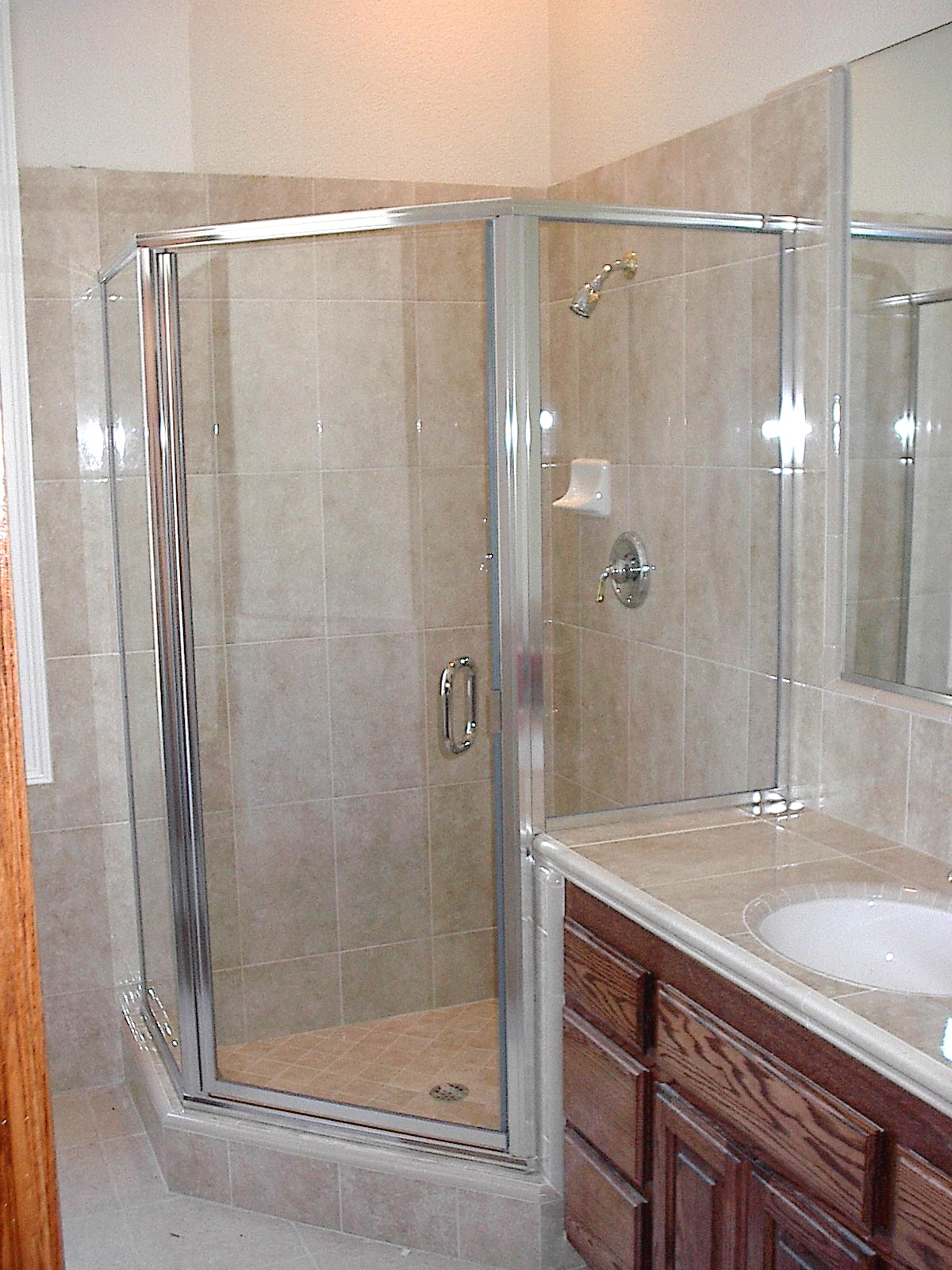hexagonal framed shower enclosure with swinging door