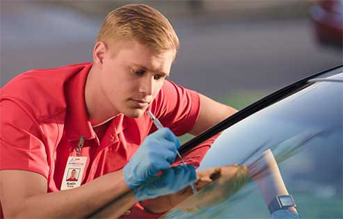 Glass Doctor specialist repairing a windshield crack