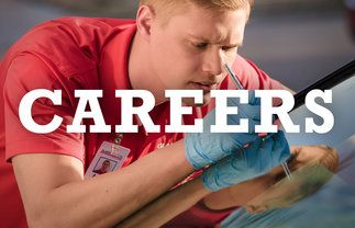 A technician working on a windshield with a careers tagline over his picture