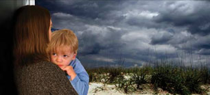 Child being held by parent with a storm in the background