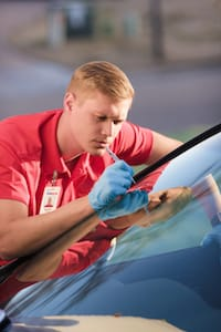 Picture of specialist repairing a windshield