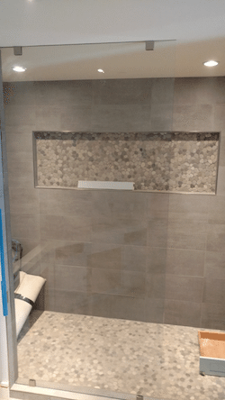 walk in shower with single fixed panel to ceiling