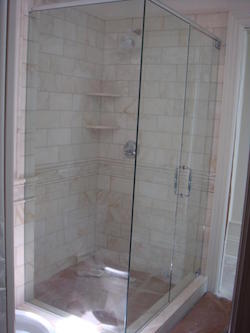 90 degree frameless shower enclosure with header