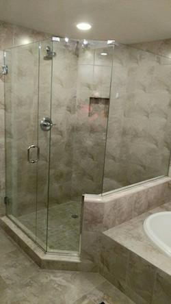neo-angled frameless shower enclosure