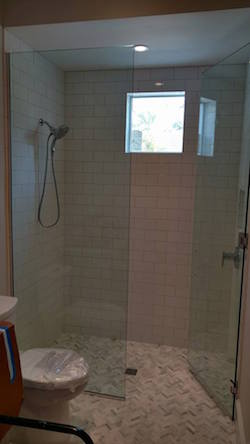 in-line frameless shower enclosure