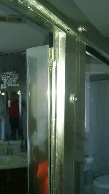 tilting shower door