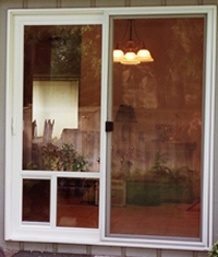 Patio door after custom pet door has been installed.
