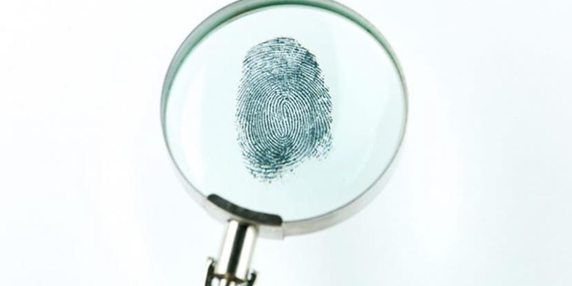 A magnifying glass over a fingerprint