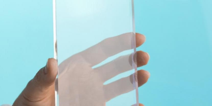 A piece of plexiglass being held up by a hand