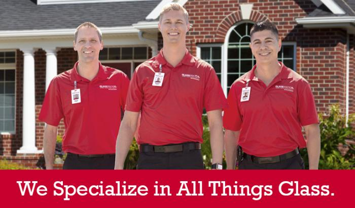 "Glass Doctor specialists in front of a house with ""We Specialize in All Things Glass"" written below it"