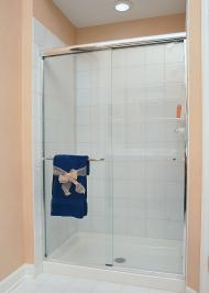 framed shower enclosure with sliding door