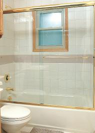 framed tub enclosure with sliding door