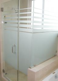 square frameless shower enclosure with striped privacy glass and swinging door