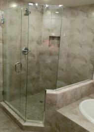 frameless shower door with thick smokey glass swinging door