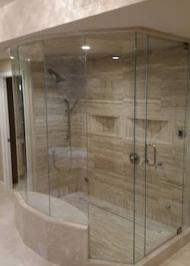 frameless all-glass shower enclosure with ceiling mounting and swinging door