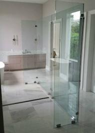 rectangle shower enclosure with heavy waterfall glass and swinging door